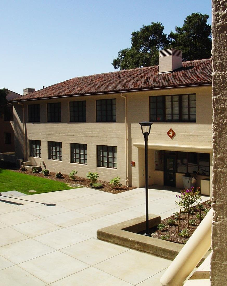 Exterior view of Clark Kerr Campus building on U.C.Berkeley, surrounded by landscaping and trees