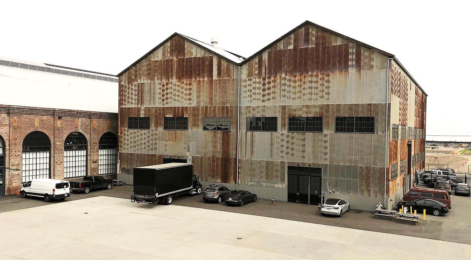 Exterior view of rusted metal building at Pier 70, Building 14 in San Francisco