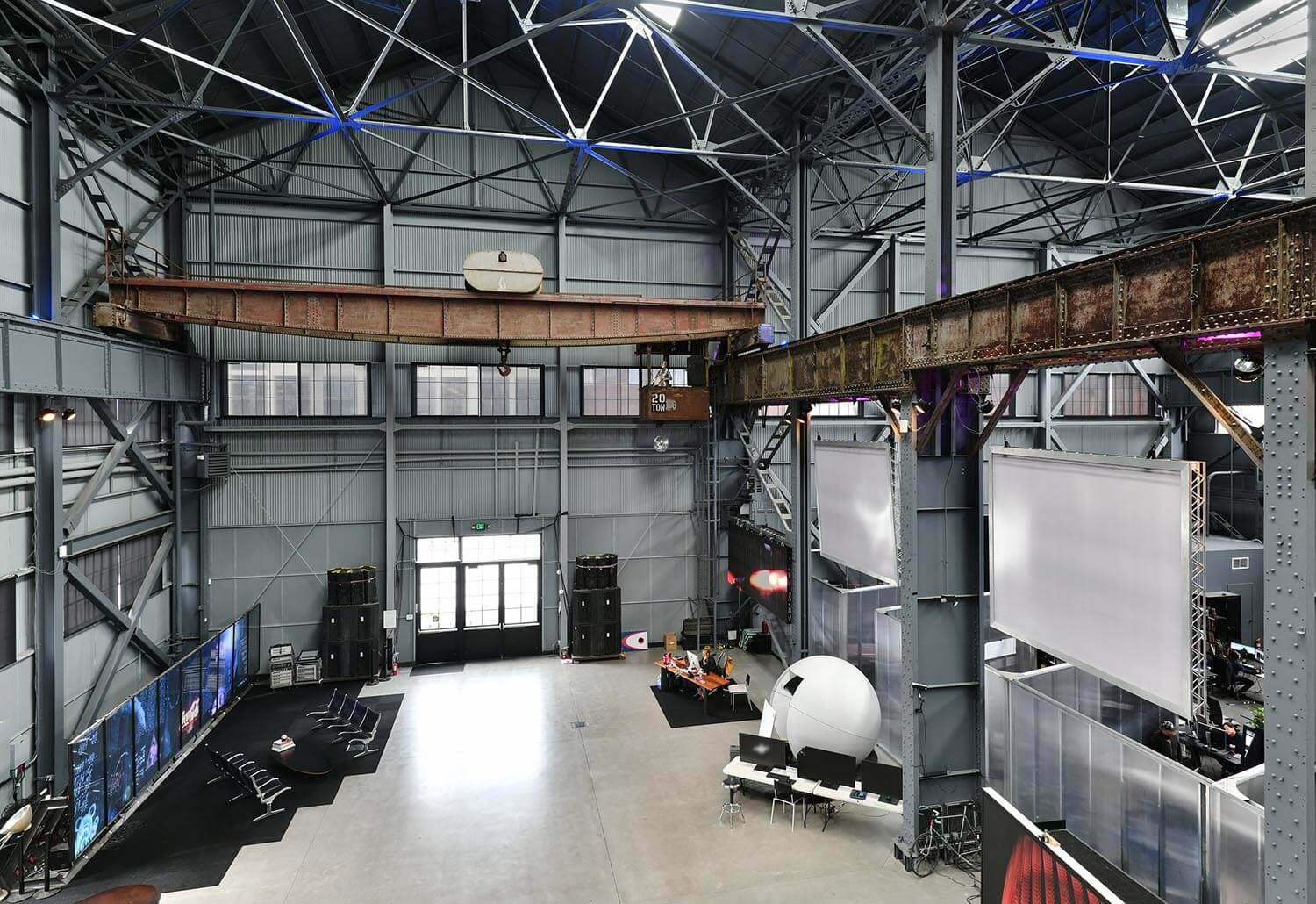 Interior view of spacious, open room at at Pier 70, Building 14 in San Francisco with metal walls and massive overhead crane